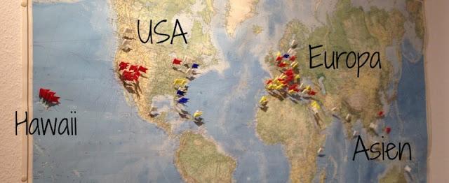 Pinnadeln auf der Weltkarte